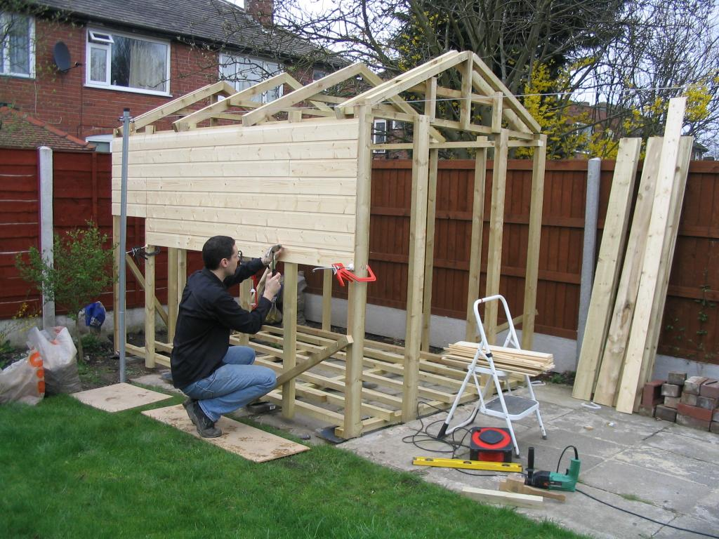 Building a shed did hammering on the shiplap solutioingenieria Choice Image